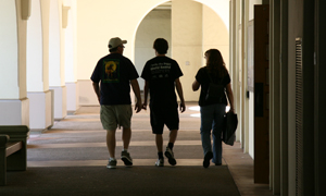 photo of family walking down breezeway on campus