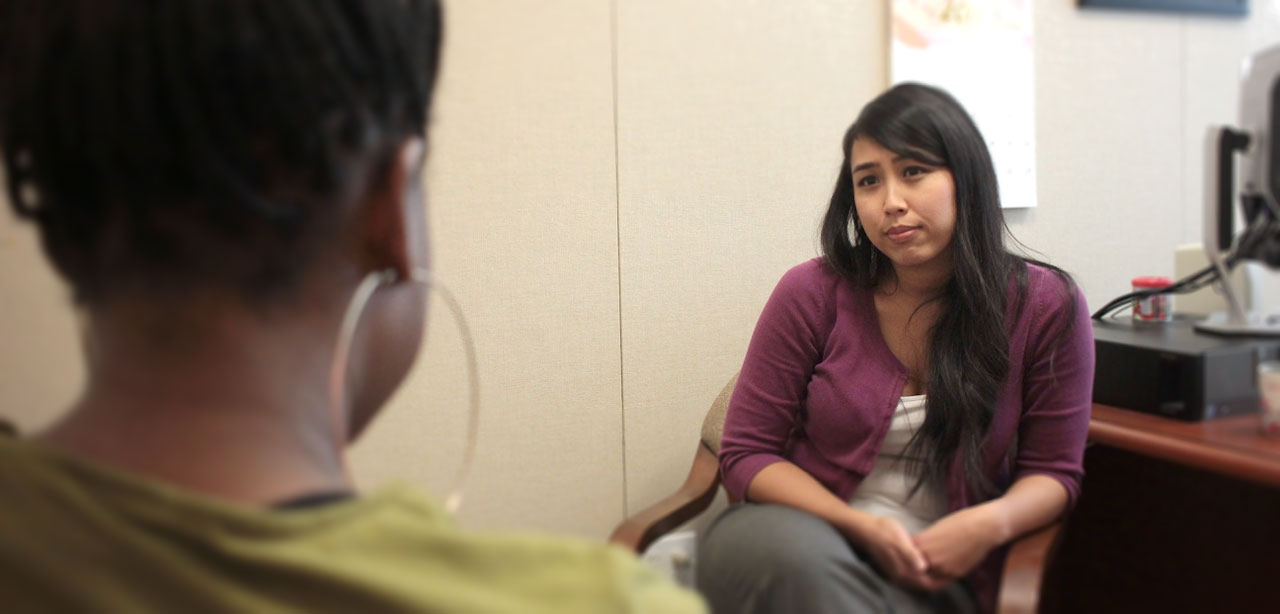 therapist in office talking with student confidentially
