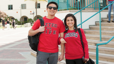 Photo: Two students in SDSU t-shirts