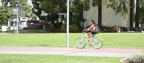 girl on bicycle riding on campus