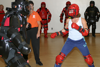 studen in self defense class wearing self defense gear