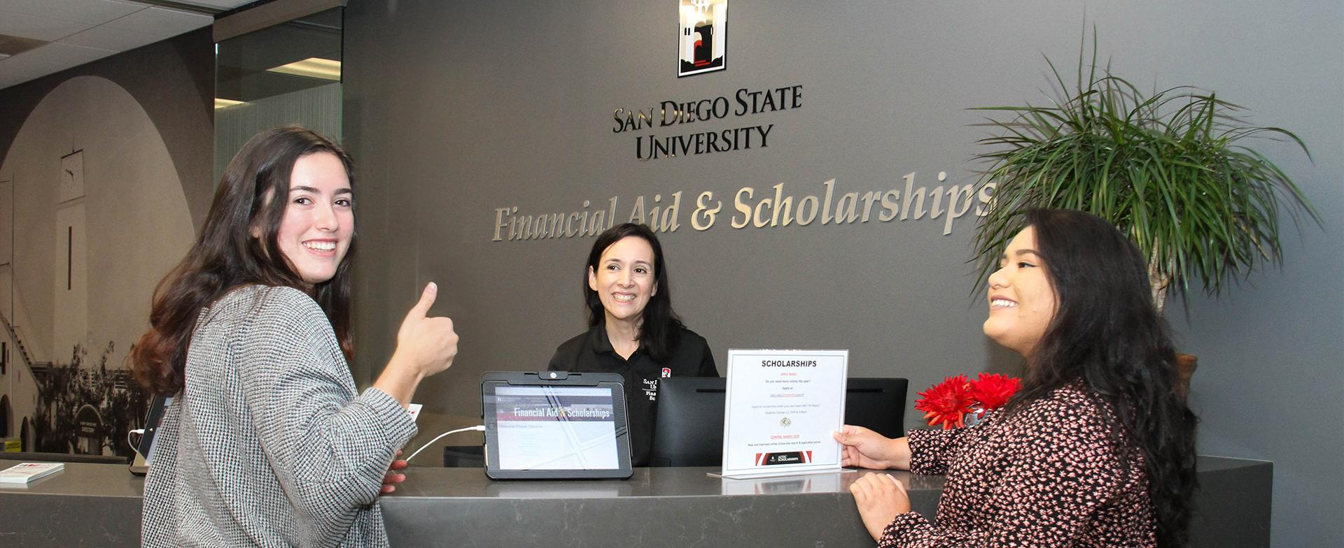 photo of students at front desk in financial aid office