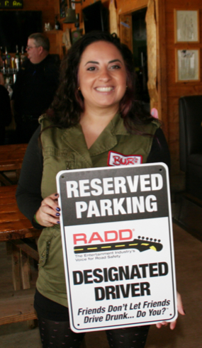 RADD student holding designated driver sign