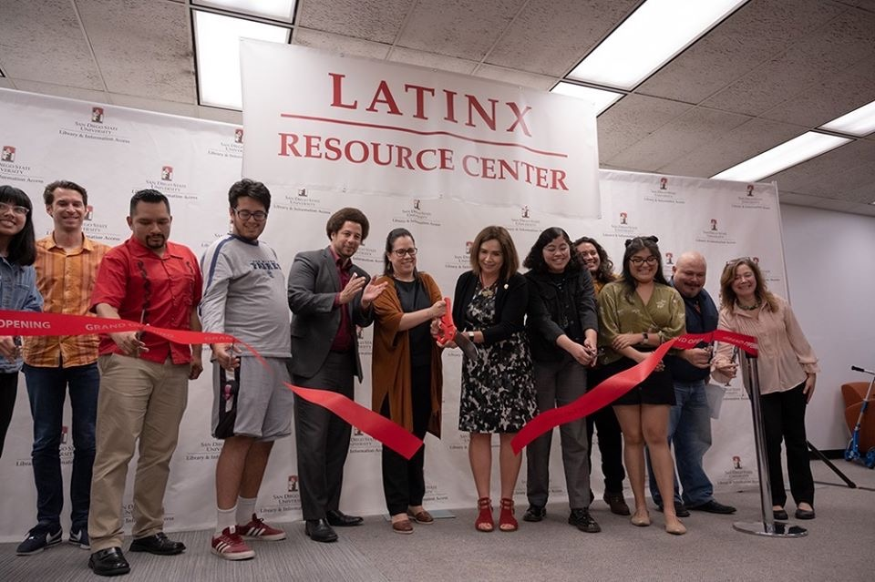 group photo of ribbon cutting of Latinx center opening